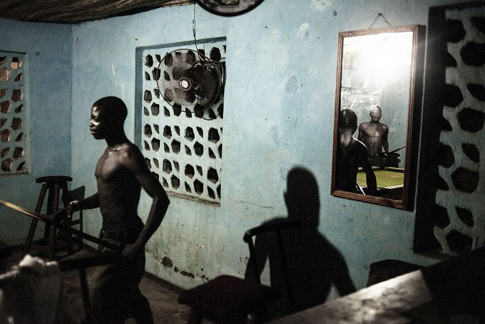 AFRICA. Malawi, February 03, 2015. Makhanga, Nsanje District. Congolese (Congo DRC) local workers play pool in the headquarters of an international NGO. © Luca Sola 2015