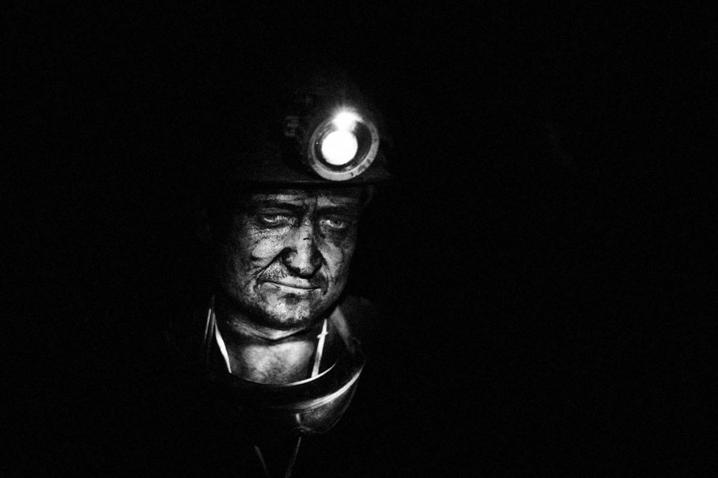 """Poland, Silesia Region, Zabrze. September 2009. Sosnica- Makoszowy Coal Mine. Portrait of a miner working at 850 m under earth. Health and life of miners are often at risk. Sosnica- Makoszowy Coal Mine arose from merger of two mines, coal mine  """"Sosnica"""" in Gliwice and coal mine Makoszowy in Zabrze.  Levels of mining can be found at a depth between 530 and 930 m. The ability of mining amounts about 12 000 tons per day, the mining area amounts 28,4 km2.. Nowadays 60% of polish energy comes from burning black coal, the biggest enemy of our climate. Poland is not one of the biggest  countriest and doesnt have big population but contributes to climate change and is in first 20 countries that produce biggest amount of CO2. in 2004-2005 polish emmisions increases for more than 2 mln tones Whith China , Australia and Republic of South Africa  , Poland belonges to countries that are most dependent on coal. Only 3% of polish energy comes from climate-friendly sources. Poland is Eupean leader in power industry energy-consuming . (Polish power industry consumes biggest amount of energy to produce energy)."""